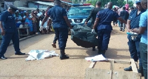File photo of police carrying a body