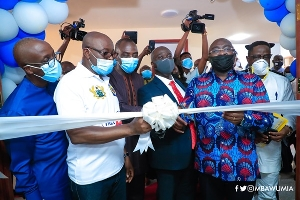 Vice-President Dr Bawumia cutting the ribbon to open the project