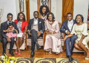 Bishop Charles Agyinasare (M) with his family