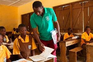 Teacher inspecting a student's work