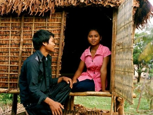 Kreung girl and her suitor chatting at her love hut