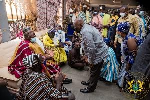 Nana Akufo-Addo before a chief