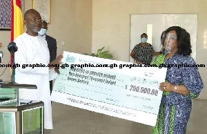 Kenney Agyapong presenting a cheque to the Minister of Foreign Affairs