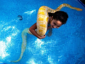Inbar and her yellow serpent named Belle